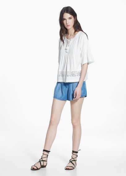 Bluse mit durchbrochenen borten | MANGO