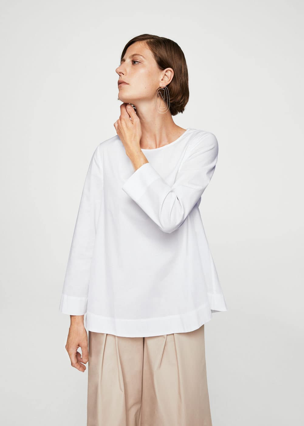 Back button blouse | MANGO