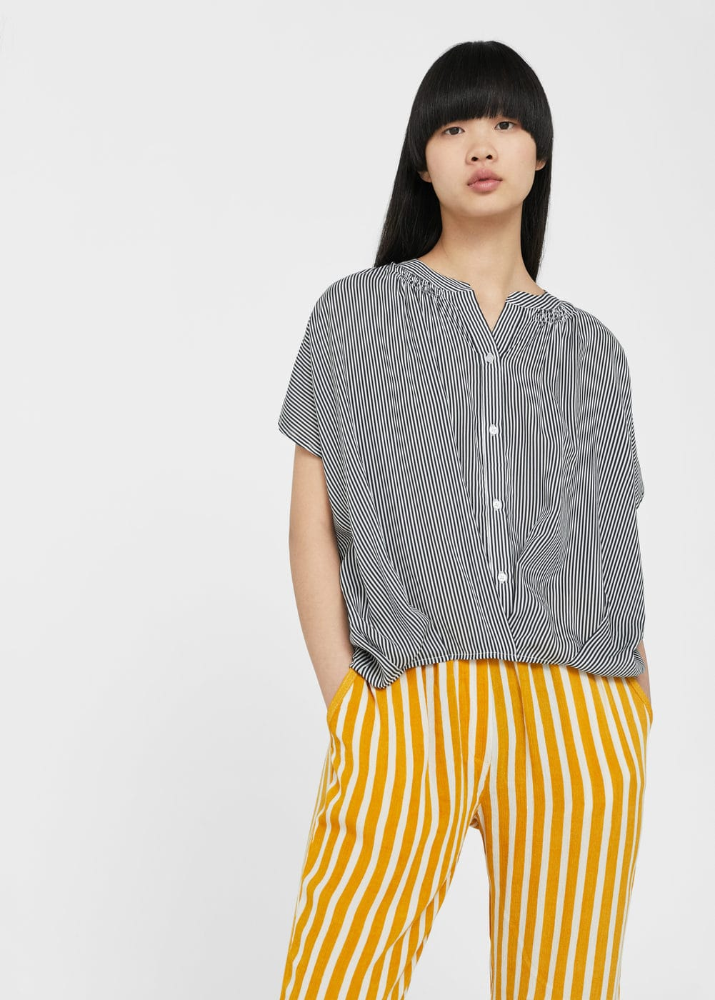 Flowy striped blouse | MANGO