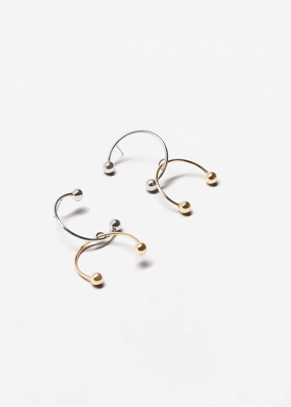 Piercing detail earrings | MANGO