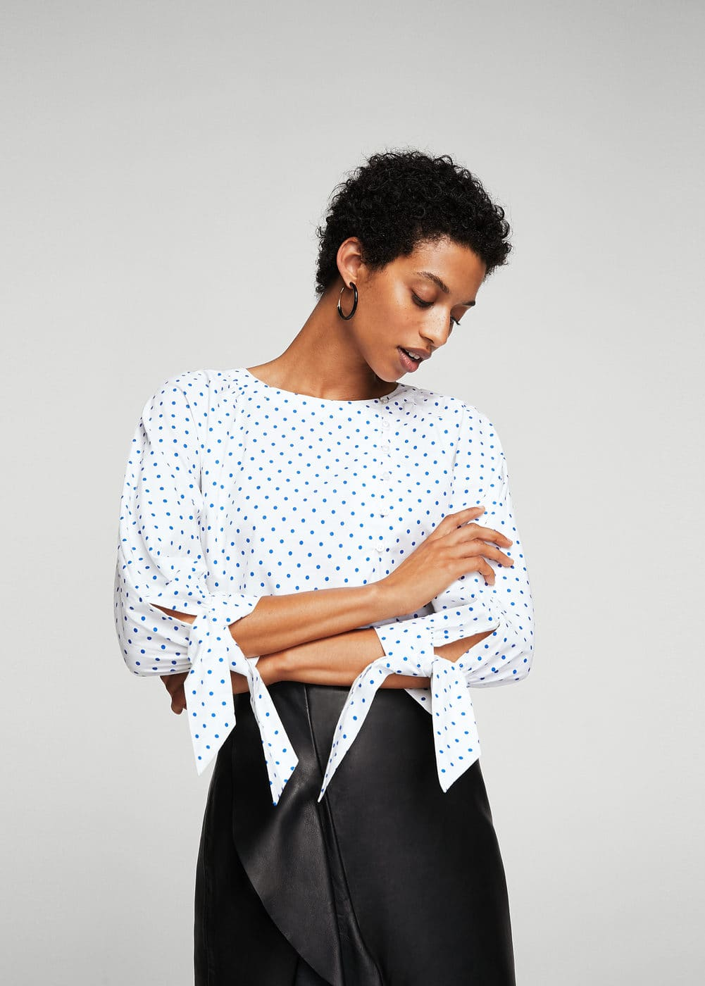 Buttoned polka dots blouse | MANGO