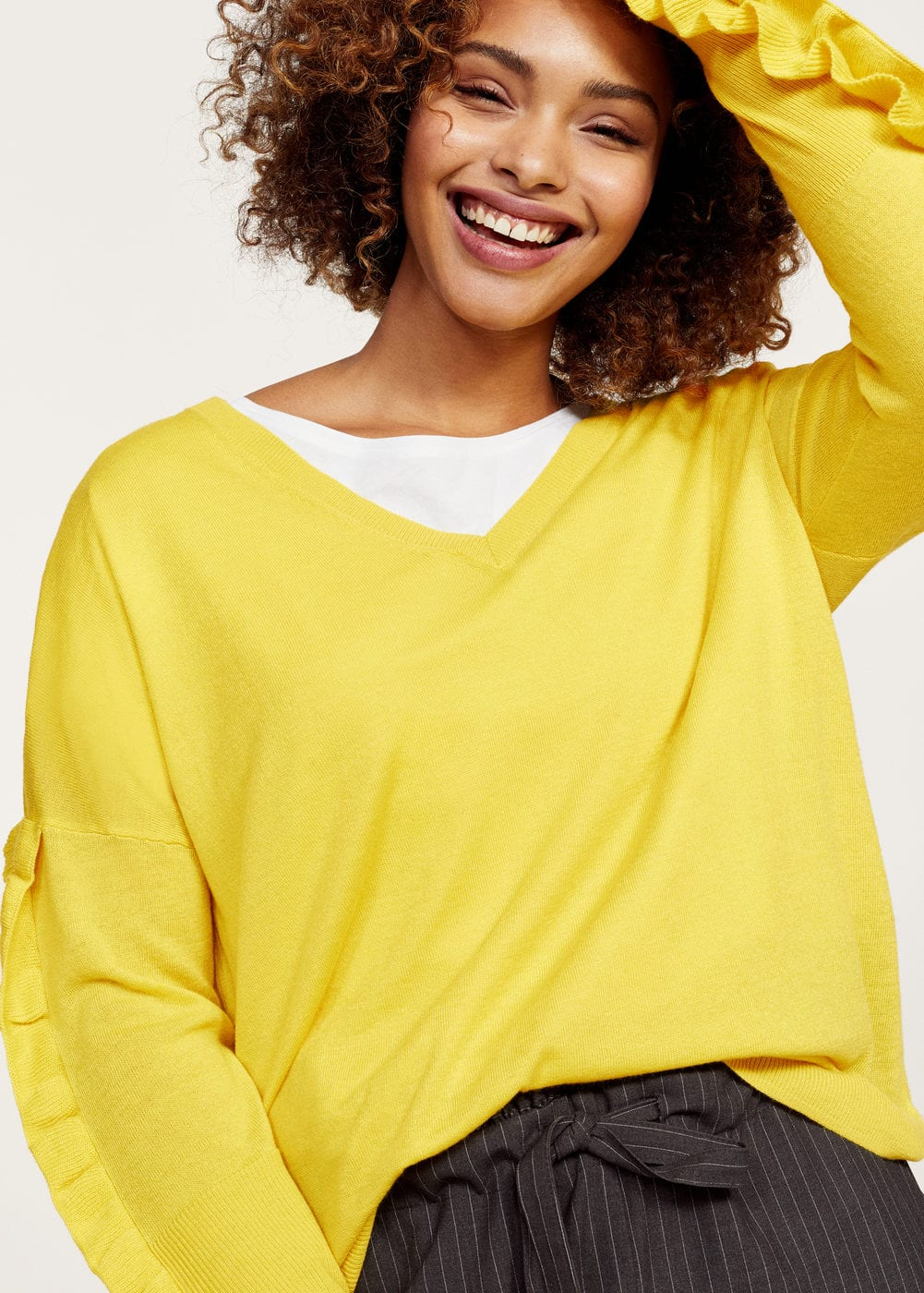 Ruffled sleeve sweater | MANGO