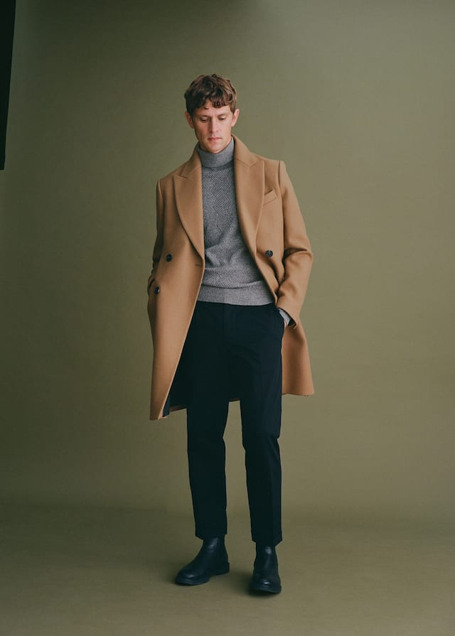 Mango overcoat styled with a grey roll neck.
