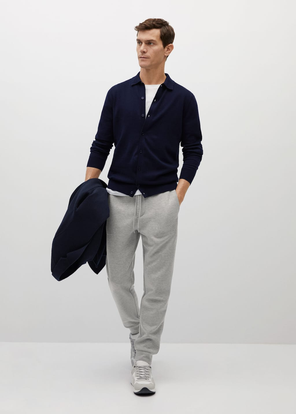 Sweatpants styled with a t-shirt and a knitted polo.