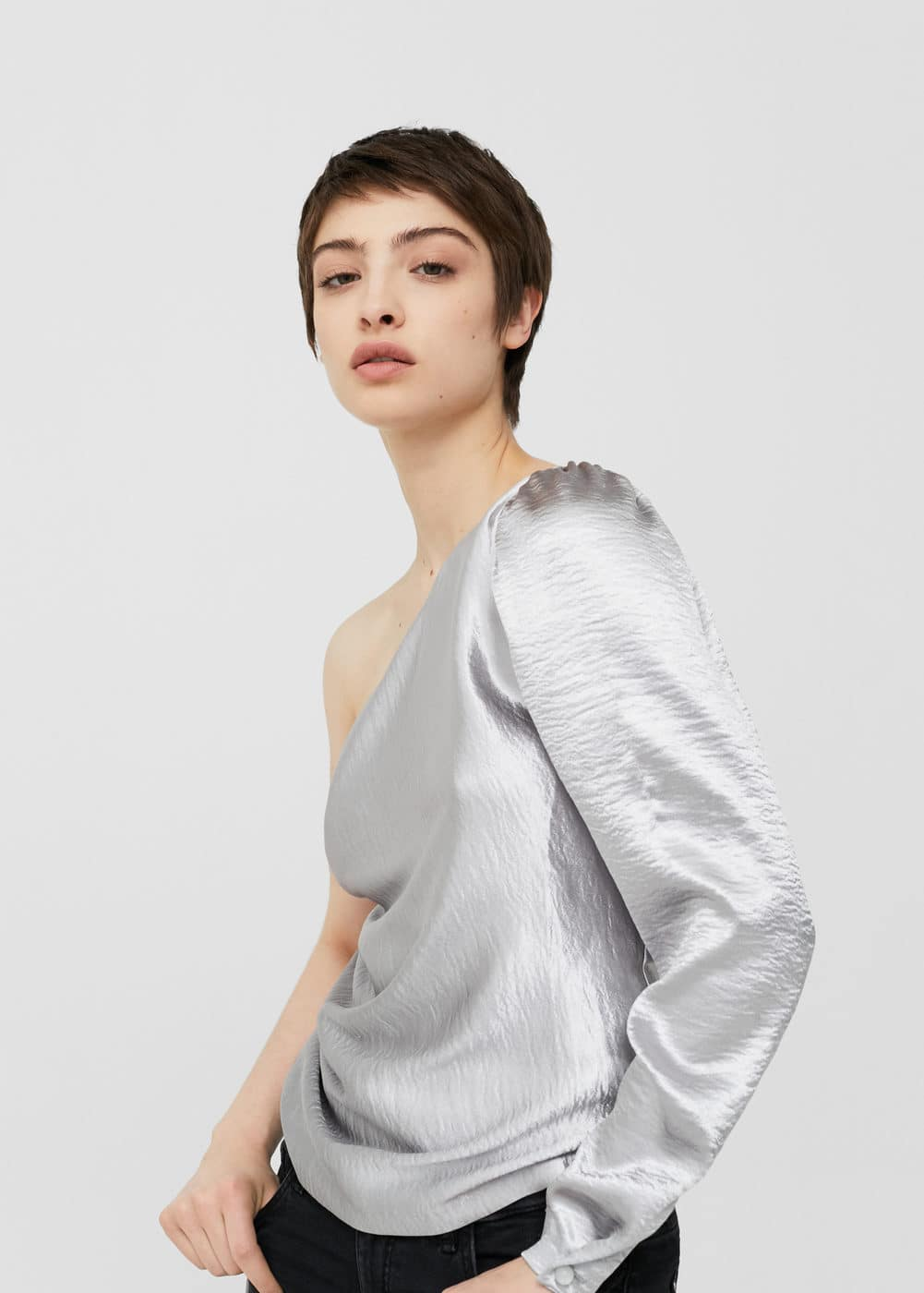 Asymmetric metallic blouse | MANGO
