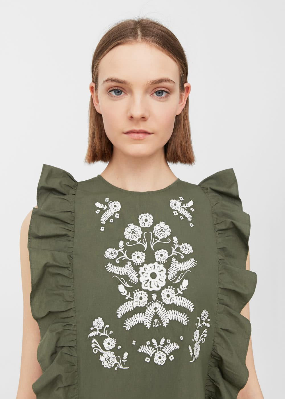 Ruffles embroidered top | MANGO